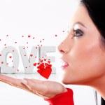 žena fouká srdce — Stock fotografie