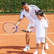Royalty-Free Stock Photo: Father and son playing tennis