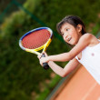 Foto Stock: Girl playing tennis
