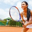 Foto Stock: Womplaying tennis