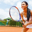 Stock Photo: Womplaying tennis
