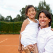 Stock Photo: Family at a tennis court