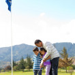 Father and kids playing golf — Stock Photo