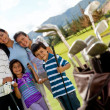 Family of golf players — Stock Photo
