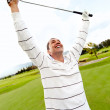 Man winning at golf - Stock Photo