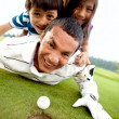 Stock Photo: Family at the golf course