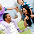 Happy family outdoors — Foto de Stock