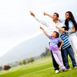 Family outdoors pointing — Stock Photo