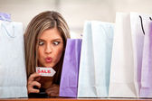 Compulsive shopping woman — Stock Photo