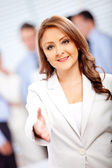 Welcoming business woman — Stock Photo