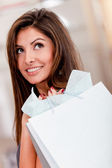Thoughtful female shopper — Stock Photo
