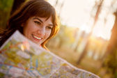 Female with a map — Stockfoto