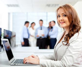 Business woman at the office — Stock Photo
