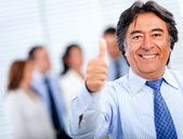 Business man with thumbs-up — Stock Photo