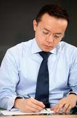 Male teacher grading exams — Stock Photo