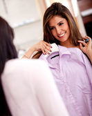 Woman showing her purchases — Stock Photo