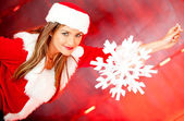 Female Santa with a snowflake — Stock Photo
