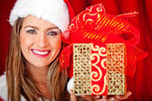 Mrs. Claus with a present — Stock Photo