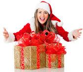Weibliche santa mit geschenken — Stockfoto