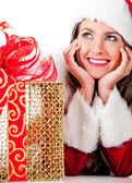 Nachdenkliche frau santa mit präsentiert — Stockfoto