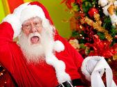 Santa worried about wish list — Stock Photo