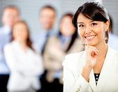 Mujer con un grupo empresarial — Foto de Stock