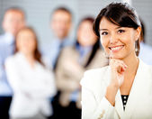 Woman with a business group — Stock Photo