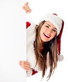 Mrs. Claus with a banner — Stock Photo