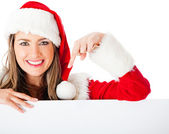 Mrs Claus pointing at a banner — Stock Photo