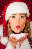 Mrs Claus blowing snow — Stock Photo
