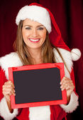 Mrs Claus with a blackboard — Stock Photo