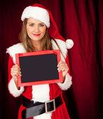 Female Santa with a blackboard — Stock Photo