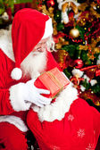 Santa Claus with presents — Stock Photo