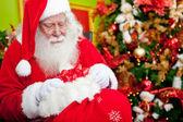 Santa Claus leaving gifts — Stock Photo