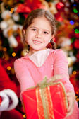 Girl with a Christmas present — Stock Photo