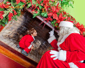 Santa revealing a secret — Stock Photo
