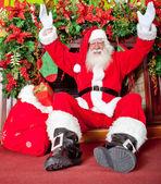Santa in the chimney — Stock Photo