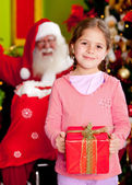Christmas girl with a present — Stock Photo