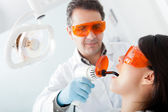 Dentist fixing a cavity — Foto Stock