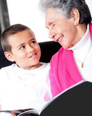 Grandmother reading to grandson — Stock Photo