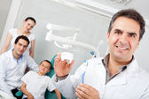 Dentist holding a toothbrush — Stock Photo