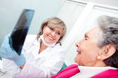 Dentist with an elder patient — Stock Photo