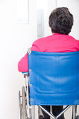 Old woman in wheelchair — Stock Photo