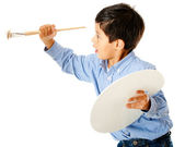 Boy painting on the wall — Stockfoto