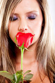 Woman smelling a rose — Stock Photo