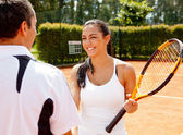 Couple playing tennis — Stock Photo