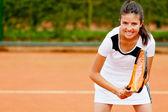 Dívka si hraje tenis — Stock fotografie