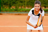 Girl playing tennis — Stock fotografie