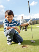Boy playing golf — Stock Photo