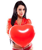 Sexy woman holding a heart — Stock Photo